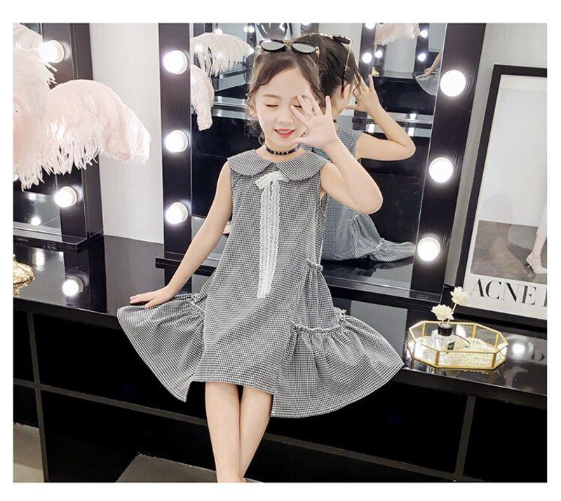 Váy kẻ caro nhún tầng 2 bên eo cách điệu giá sỉ, giá bán buôn