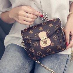 Túi nữ đeo chéo khóa cài hình hoa mã sp: 15626