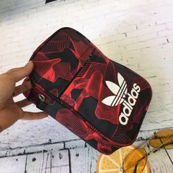 Túi xách đeo chéo thể thao mini size cao 21 Chất vải dù Bên trong có lót vải dù coa tên mẫu mã Có giảm giá Vui lòng inb