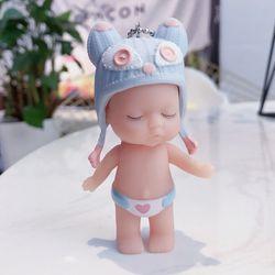 móc khóa bé ngủ đứng nón len quần tim xanh khói giá sỉ