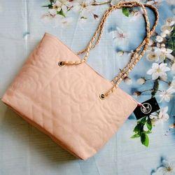 Túi xách du lịch Chanel hoa trà da pu giá sỉ