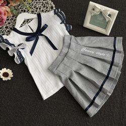 Bộ áo sơ mi cánh tiên buộc nơ xinh xắn mix cùng chân váy xếp ly kiểu Hàn Quốc giá sỉ