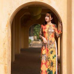 Áo dài thổ cẩm nhiều họa tiết màu cam giá sỉ