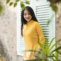 Áo dài truyền thống thêu sen màu vàng giá sỉ