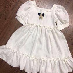 Đầm thiết kế đính nơ bé gái giá sỉ tphcm