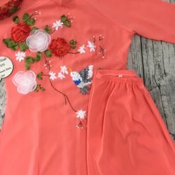 Áo dài cam thêu ruyban hình hoa giá sỉ