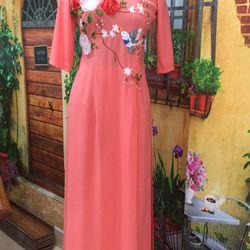 Áo dài cam thêu ruyban hình hoa giá sỉ, giá bán buôn