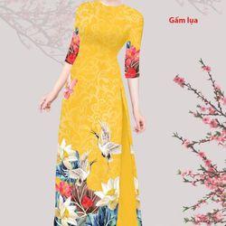 Set áo dài truyền thống gấm tơ nền vàng hình in hoa sen hạc giá sỉ