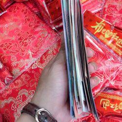 Túi lì xì tiền đô thật 100 52 tờ cho bộ siêu tập 28 nước giá sỉ