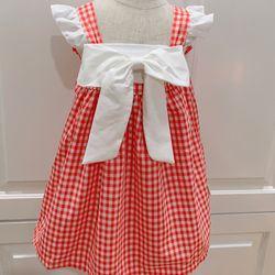 Đầm trẻ em caro đỏ nơ trắng giá sỉ
