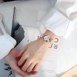 Đồng hồ nữ dây hoa kim loại giá sỉ