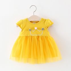 Váy thun đính bông trang trí chân váy voan 2 lớp màu vàng giá sỉ